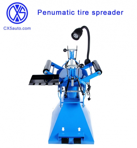 Penumatic tire spreader